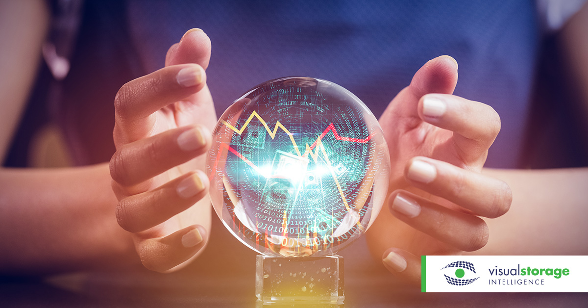 storage capacity management | person holding crystal ball with graphs inside