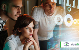 finding hidden storage   three IT professionals look at a data hologram